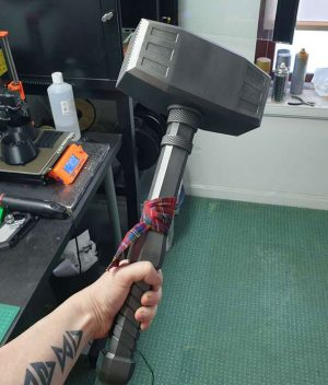 Sledge sledgehammer cosplay prop from Six Siege with tartan held in hand
