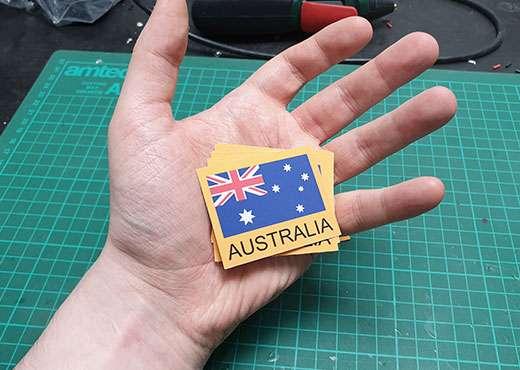 Hand holding sticker of Australian flag